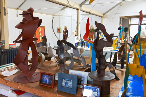 A photo of some sculptures in Allen Jones' studio