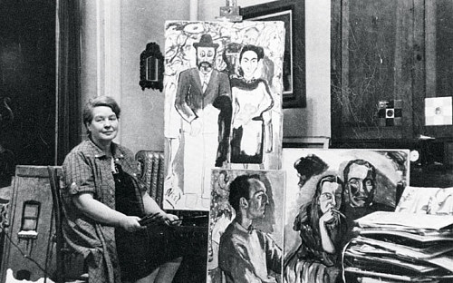 A photograph of Alice Neel in her New York studio
