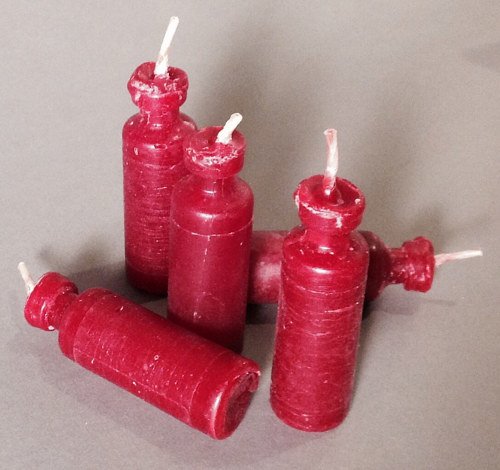An artwork of candles shaped like insulin bottles