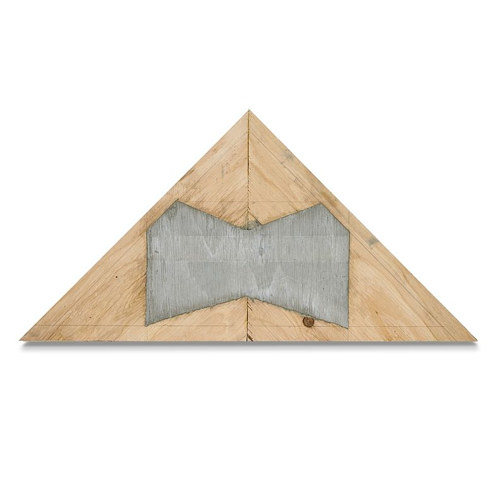 A triangular piece of plywood with cement embedded at its center