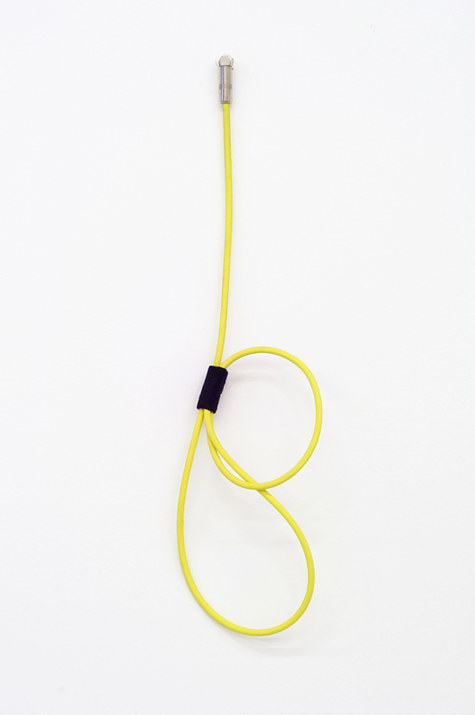 A sculpture made from a neon yellow instrument cable