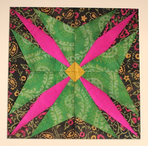 textile artwork with pink and green fabric