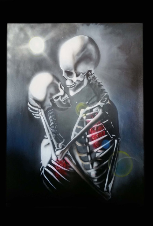 A painting of two skeletons in an embrace
