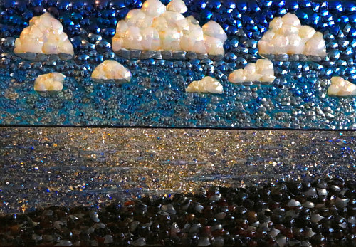 A mosaic made from glass beads depicting a seascape