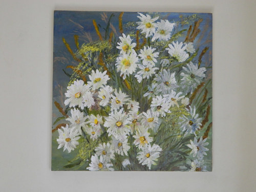 A painting of potted daisies