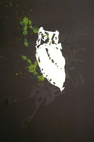 A screen print of a white owl on a black background