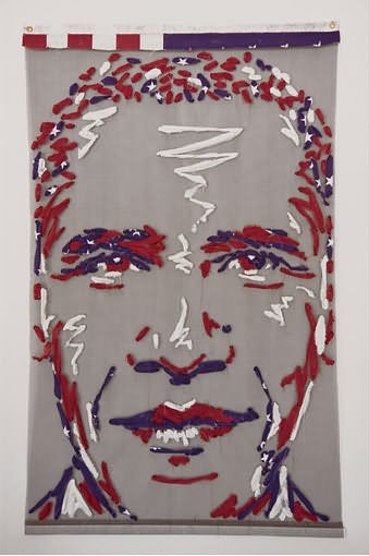 A portrait of Obama made from a flag woven through mesh