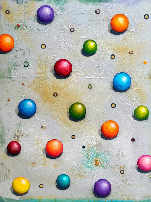 A painting of some bright colored marbles on canvas