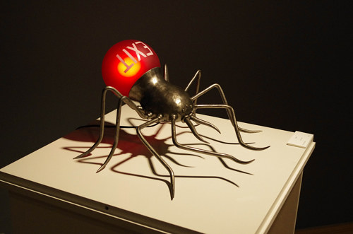 A cast iron lamp shaped like a large spider