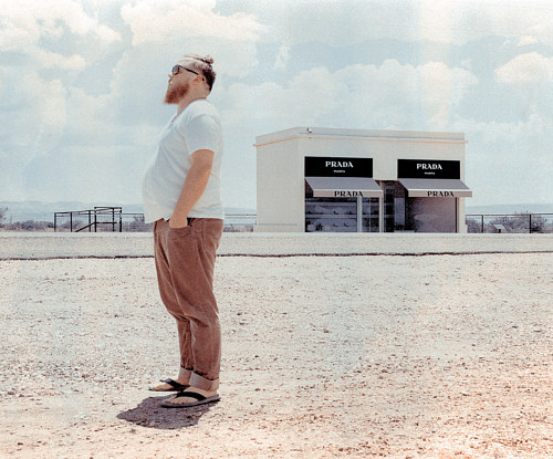 A photo of a man standing in front of Prada Marfa