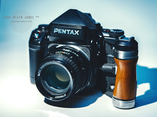 A commercial photograph of a Pentax camera