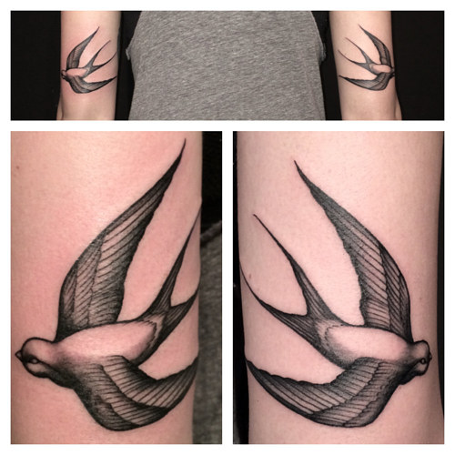 A tattoo of two swallows, one on each arm
