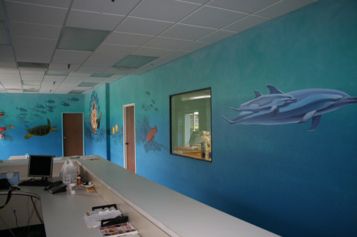 A mural painted inside an office space of an underwater scene