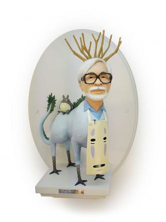 A sculpture of Hayao Miyazaki combined with imagery from his films