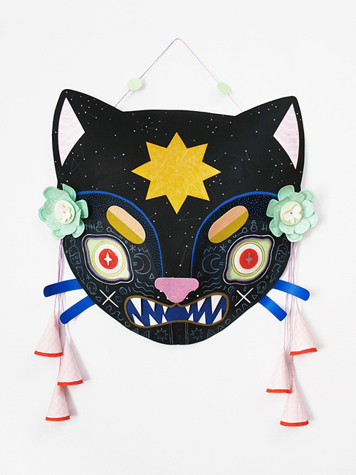 A stylized mask of a cat's face