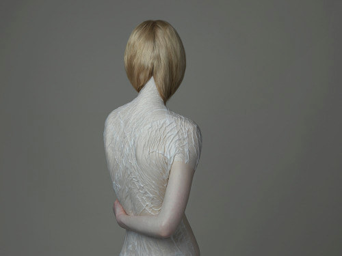 A photograph of a model from behind