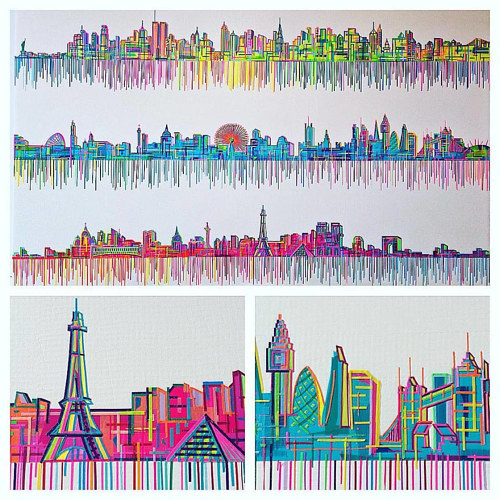 An image of several city skylines depicted in colorful strips of tape