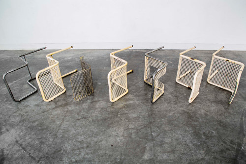 An installation using the steel forms of several outdoor chairs