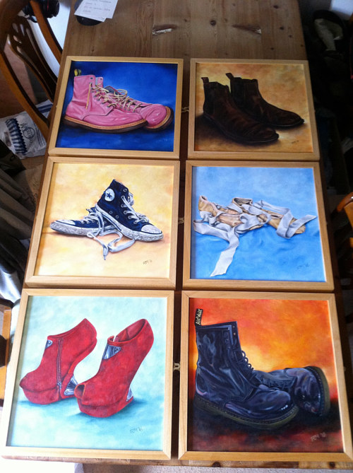 A photograph of six small paintings of different pairs of shoes