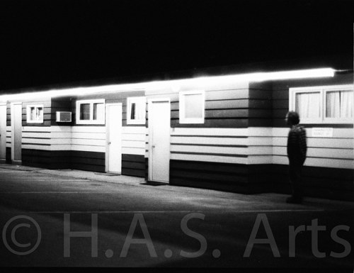 A blurred, black and white photograph of a house