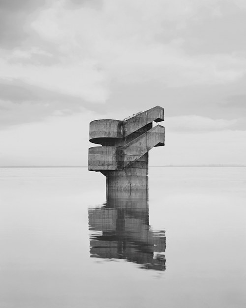 A photographic image of an unidentified structure on an empty beach