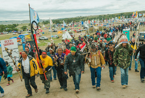A photograph of protesters at the site of the Dakota Access Pipeline