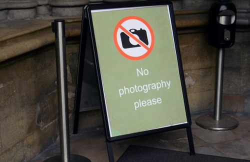 A photo of a no photography sign
