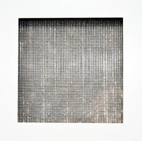 A mixed media artwork organized as a grid of materials