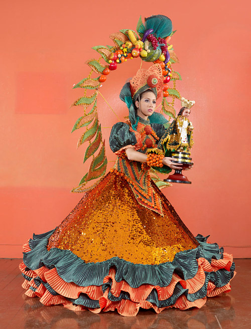 A photograph of a woman in elaborate traditional costume