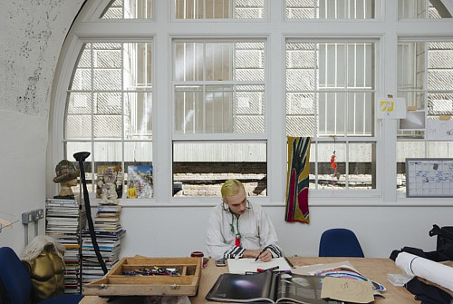 A photo of an English artist working in a London studio