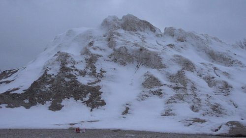 A still of a snowy mountain from an art video