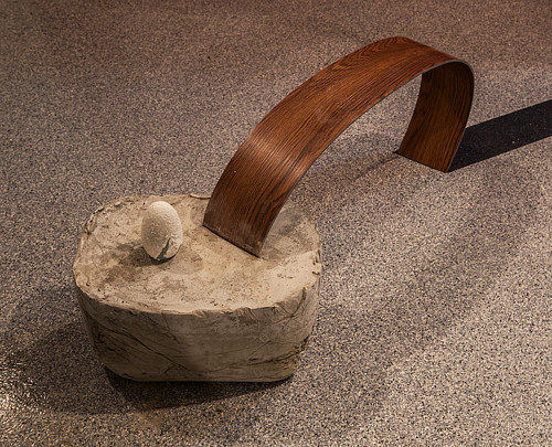 A sculptural installation utilizing wood and stone