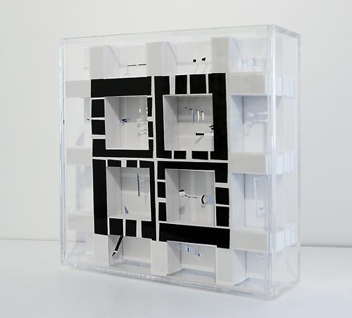 An artworks made up of a plexi glass box and paper