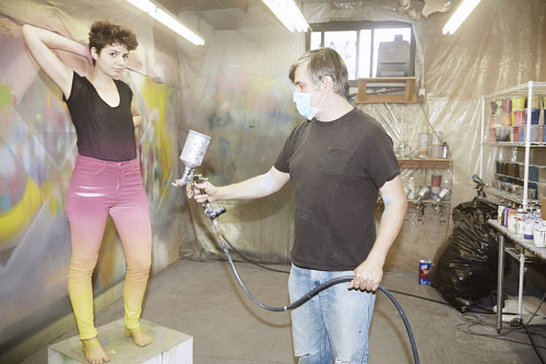 A photo of Rob Pruitt painting a model in his studio