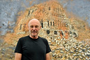 A 2009 photo of Anselm Kiefer in front of one of his paintings