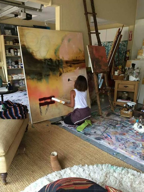 A photo of Jada Pinkett Smith at work in her art studio