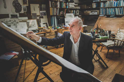 A photo of Alan Lee in his drawing studio