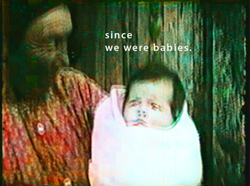 A manipulated photograph of an old woman holding a baby