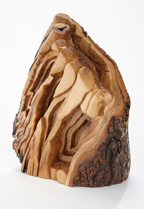 A carved wood sculpture preserving the natural look of the wood