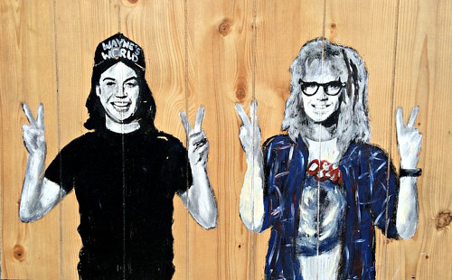 A painting of the main characters of Wayne's World on a wood board