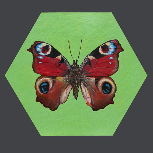A painting of a butterfly on a hexagonal board