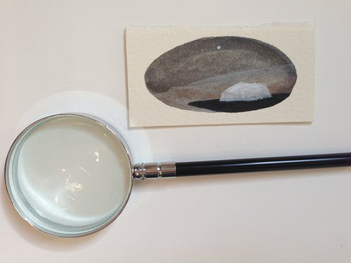 magnify glass and a small watercolour painting