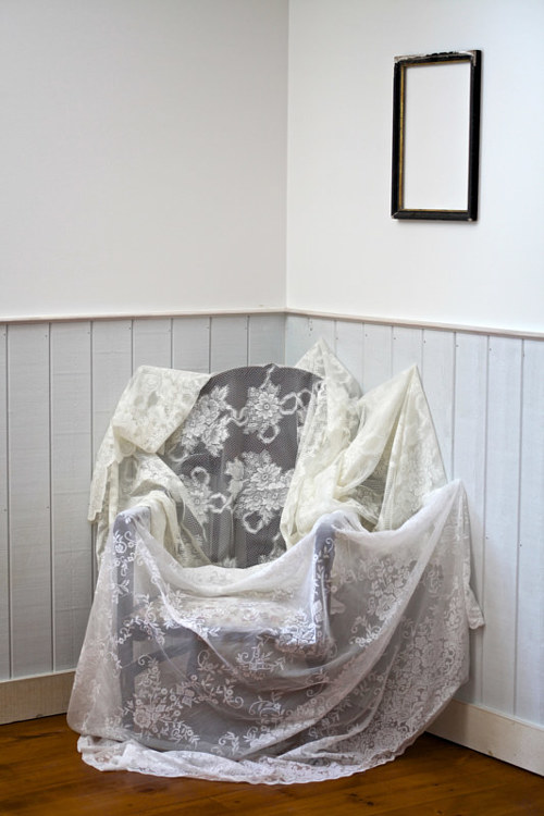 A photograph of a chair covered in fabric