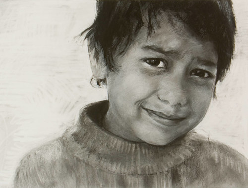 A charcoal drawing of a young boy