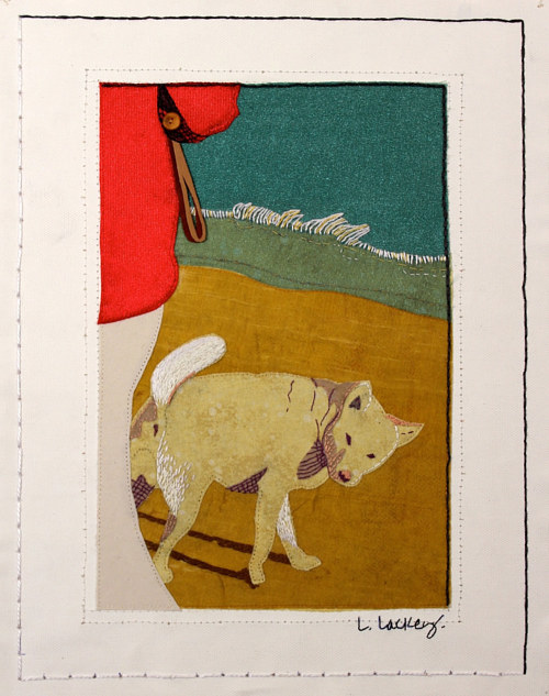 A textile artwork depicting a dog on the beach