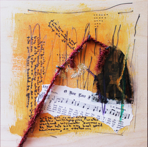 A mixed media assemblage with a torn piece of sheet music