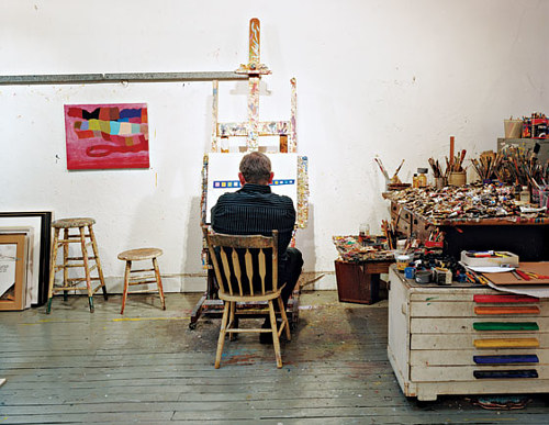 A photograph of Thomas Nozkowski at work in his studio
