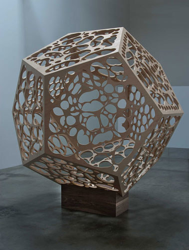 A prismatic sculpture made from aluminum and wood