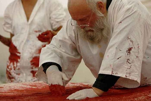 A photo of Hermann Nitsch during a 2009 performance