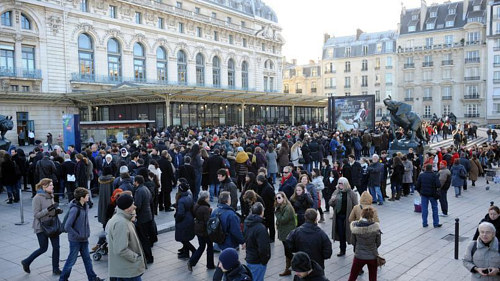A photo of crowds in front of the Musee d'Orsay in Paris